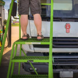 rolling ladder in use at a truck stop.
