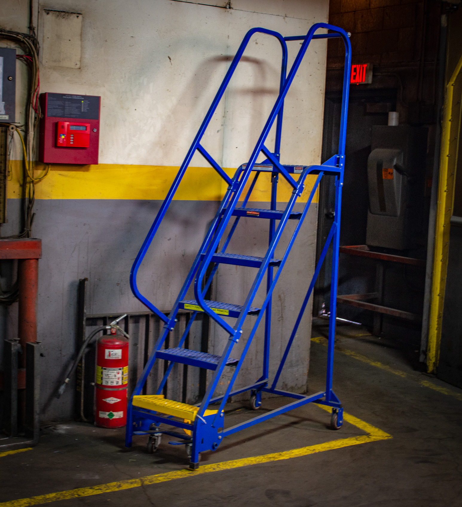 a square tube rolling ladder painted in bright blue and gold paint.