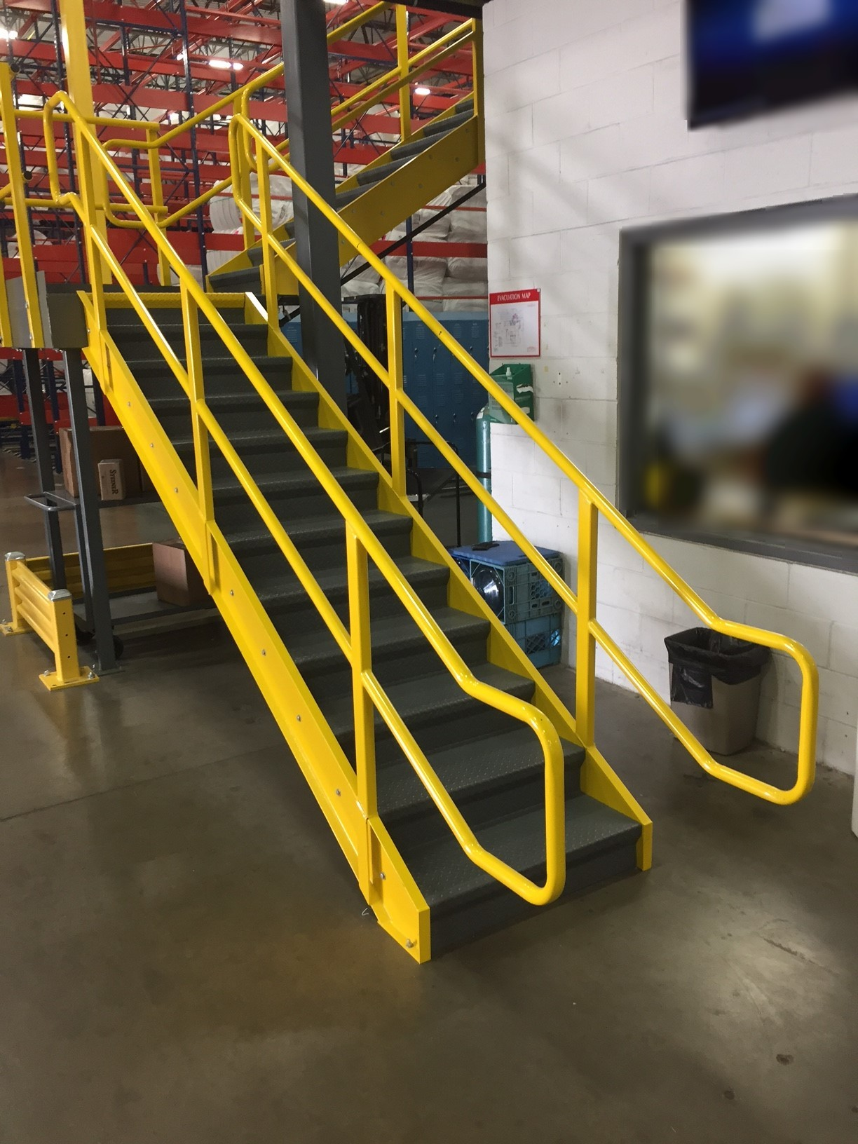Custom IBC industrial warehouse stairway system with platform